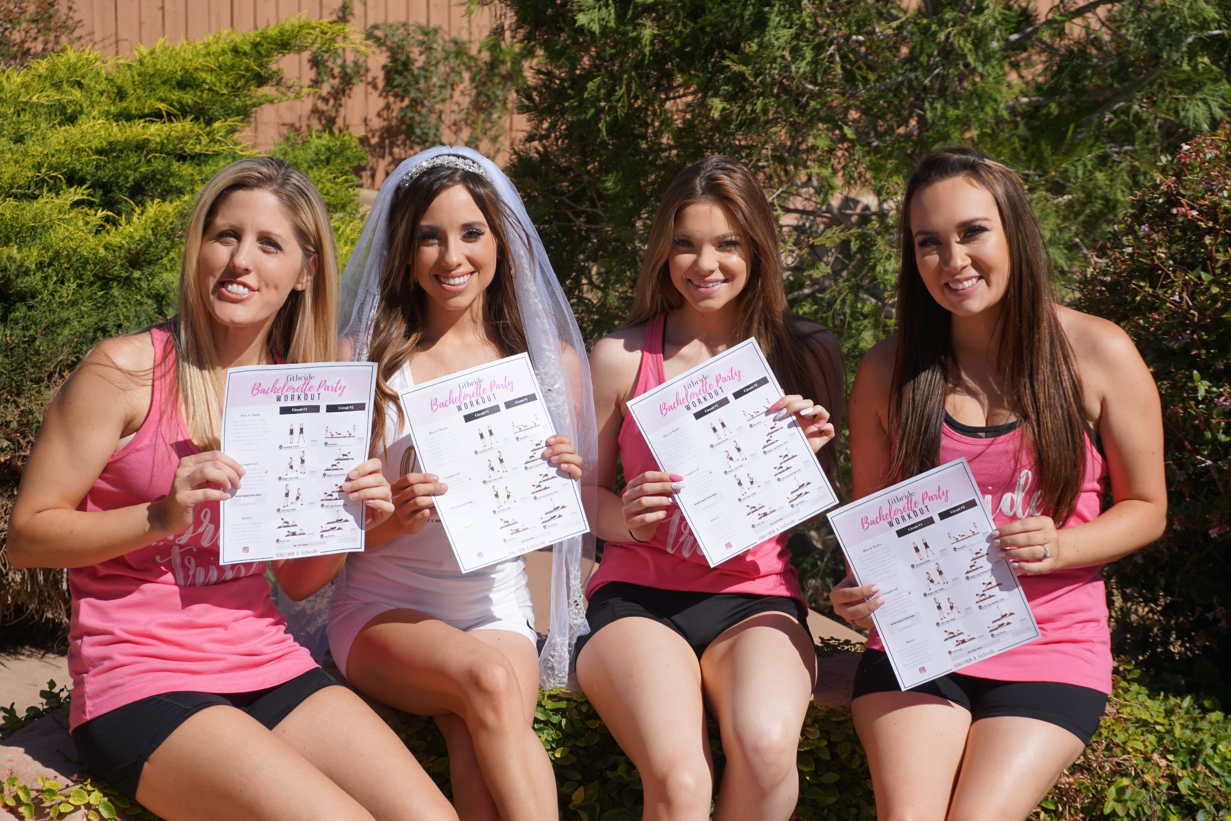 Photo of 4 women holding the Bachelorette Party workout program