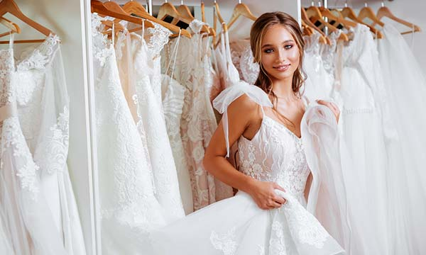Bride trying on white wedding dresses