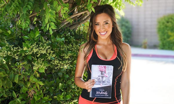 Photo of Fitbride founder Margaret Caton holding the Fitbride Workout Book